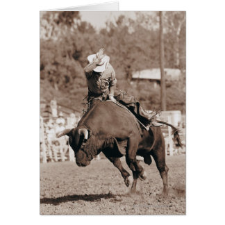 Rider about to fall off bucking bull card