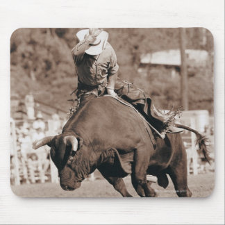 Rider about to fall off bucking bull mouse pad