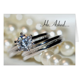 Rings and White Pearls Engagement Announcement
