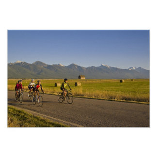 Road bicyclists ride down a back country road poster