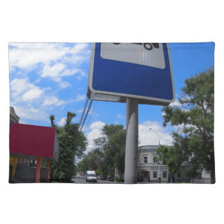 Road sign with a picture of a bus stop on a city s placemats