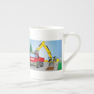 Road site with red truck and yellow excavator tea cup