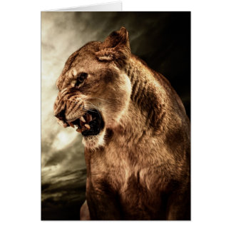 Roaring lioness against stormy sky card