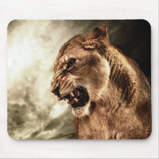 Roaring lioness against stormy sky mouse pad