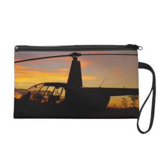 Robinson R44 helicopter at sunset Wristlet Clutch