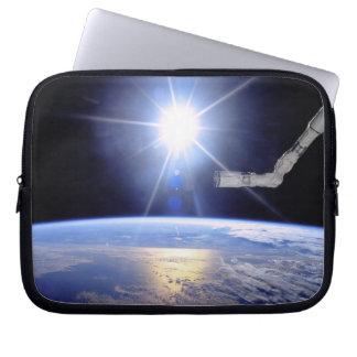 Robot Arm Over Earth with Sunburst Laptop Sleeve