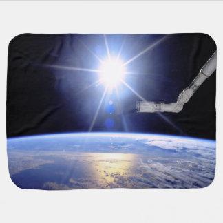 Robot Arm Over Earth with Sunburst Swaddle Blanket