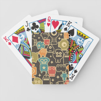 Robots on brown bicycle playing cards