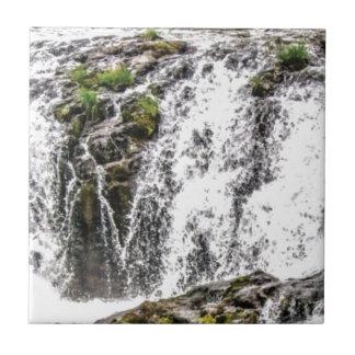 rocks fall over the falls tile