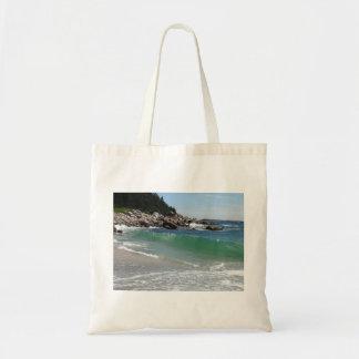 rocky coastline ocean surf tote bag