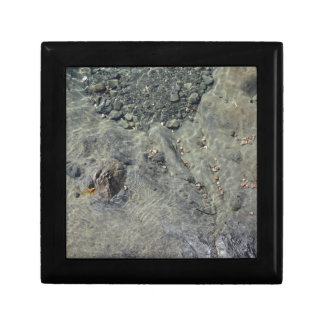 Rocky seabed through transparent sea water gift box