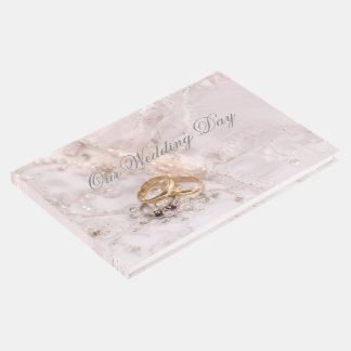 Romantic bride and grooms rings wedding day guest book