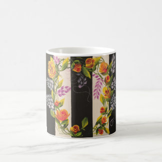 Romantic coffee mug with roses and rosebuds.