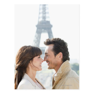 Romantic couple with the Eiffel Tower in the Postcard