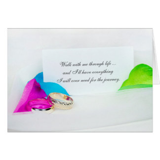 romantic love quote with rings and rose petals card