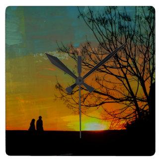 romantic peaceful sunset couple painting wall clocks