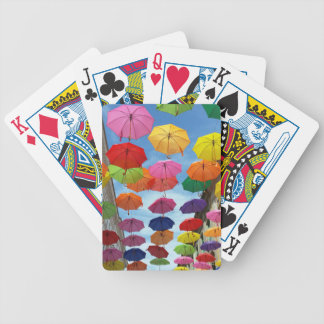 Roof of umbrellas bicycle playing cards