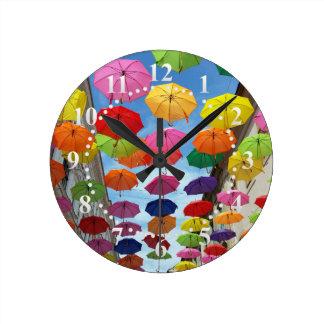 Roof of umbrellas round clock