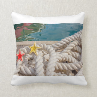 rope for mooring with two  starfish on pillow