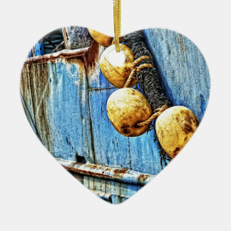 ropes and rusty ceramic heart ornament