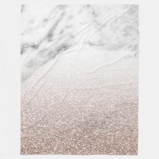 Rose gold glitter on marble blanket