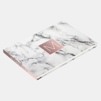 rose gold monogram on white marble look guest book