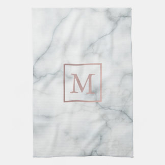 rose gold monogram on white marble towels