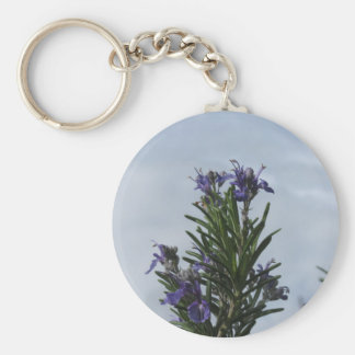 Rosemary plant with flowers against the sky keychain