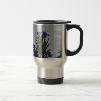 Rosemary plant with flowers against the sky travel mug