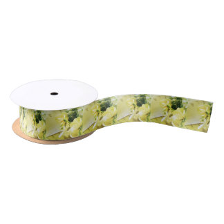 Roses, other white flowers on old handwriting satin ribbon