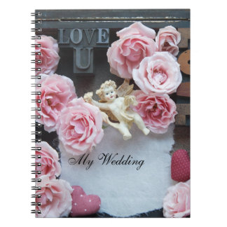Roses with love words and angel notebooks