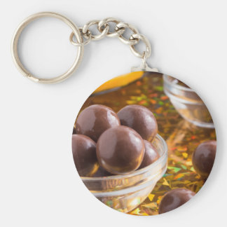Round candy chocolate close-up on a colorful basic round button keychain