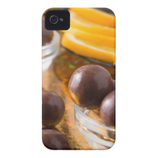 Round candy  from chocolate close-up on a colorful iPhone 4 cases