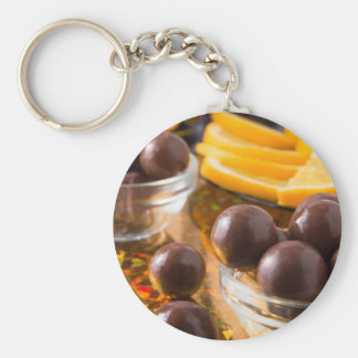 Round candy  from chocolate close-up on a colorful keychain