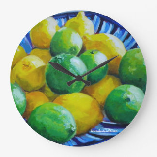 round clock with lemons and limes