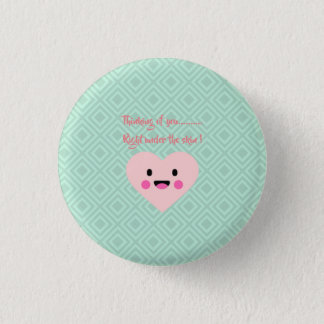 Round pink-green button with heart