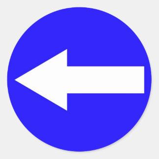 Round sticker with arrow to left