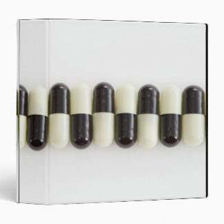 Row of Black and white pills 3 Ring Binders