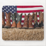 Row of cowboy boots on haystack mouse pads