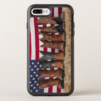 Row of cowboy boots on haystack OtterBox symmetry iPhone 7 plus case