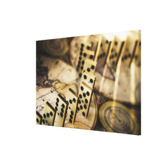 Row of dominoes on old world map 2 gallery wrapped canvas