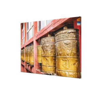 Row Of Prayer Wheels Canvas Print