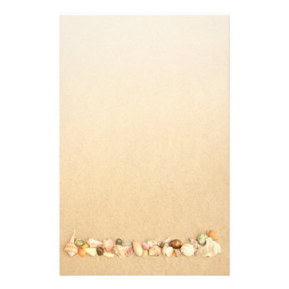 Row of Seashells on Beach sand Stationery