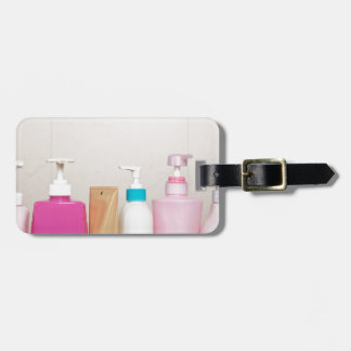 Row of toiletry bottles luggage tag
