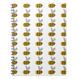 Rows of busy bumble bees spiral notebooks