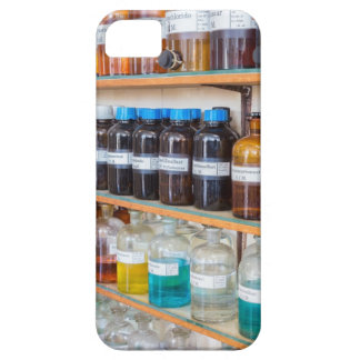 Rows of fluid chemicals in bottles at chemistry case for the iPhone 5