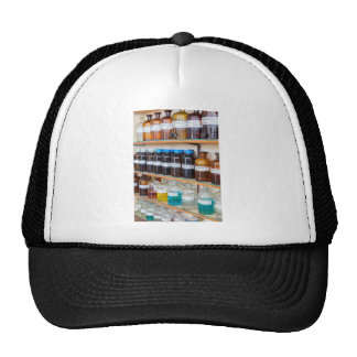Rows of fluid chemicals in bottles at chemistry trucker hat