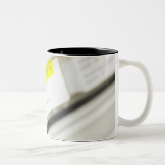 Rows of labeled medicine drawers Two-Tone mug