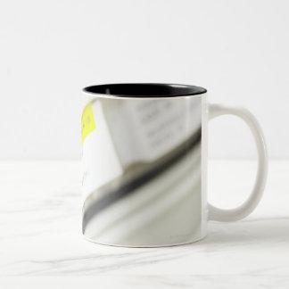 Rows of labeled medicine drawers Two-Tone coffee mug