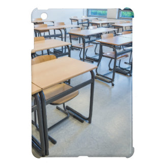 Rows of tables and chairs in classroom iPad mini case